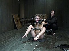 Lovely girl sits on the floor being tied up. She gets fucked deep in her throat and then toyed with a vibrator.