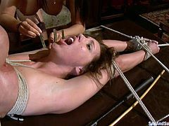 This lusty and super sexy siren Isis Love gets naked for Mark Davis and his babe. They tie her up and Mark enjoys switching from twat to twat!
