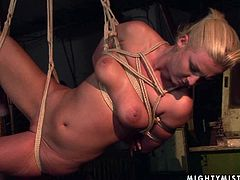Wicked mistress tortures her sex slave by fingering her pierced pussy watching her squirm. Make sure you don't miss this wild BDSM sex clip.