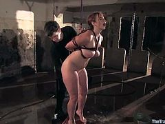 Chubby slut Bella Rossi allows Wolf Hudson to restrain her in a basement. Then Wolf plays with Bella's massive tits and makes the girl suck his dick before he drives it in her twat.