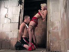Slutty blonde dominatrix Kimberly Kane is having fun with Wolf Hudson in a basement. She makes the guy suck her strapon and then rubs his dick and takes a hot ride on it.