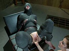 Nasty brunette gets wrapped in some material. She gets her tits tortured with electricity and pussy toyed by her unmerciful mistress.