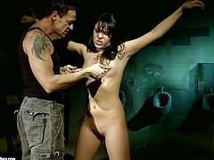 This brunette whore is the kind of girl that needs to be punished hard. Horny bondage mastre clamps clothespins on his slave's tits and then he makes her worship his rock hard cock.