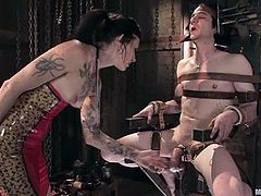Tattooed brunette chick ties the guy up with straps. Then she whips drills his ass with big dildo. Later on she sucks and rides his dick.