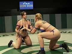 Two chubby chicks fight in a ring. Then they lick each others pussies. After that Darling gets toyed rough with a strap-on and a vibrator.