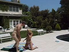 After giving a short interview, Holly Halston meets her sex partner and have a hot fuck by the pool. He slides his cock deep in her trimmed pussy while the camera is on.