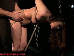 Brunette slut Rebecca Contreras is involved into some hardcore BDSM action. She is forced to suck his cock, while she is all tied up!