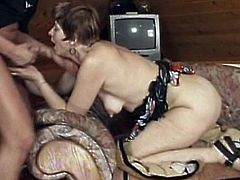 Brunette granny with short hair gets nailed doggy style