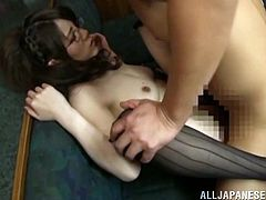 Horny Japanese chick in a corset and stockings sucks two dicks and gives a titjob. Later on she gets fucked in turn and facialed.