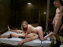 This guy will have to suck cock while getting strapon fucked by Aiden Starr who later gets fucked by the other guy in this crazy threesome.