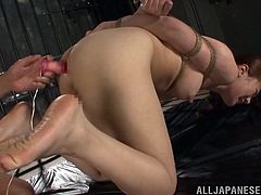 She's tied up in that prison cell and a naked, older man, plays with her sexy ass. The Nippon chick can't to nothing but endure the treatment and maybe learn how to like it. The guy inserts an sex toy in her tight anus, making her scream. The deeper he goes, the better!