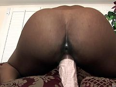 Chubby black slut with saggy boobs loves big sex toys because she got gaping fuck holes. She stuffs her cunt with huge dildo moving it in and out intensively.