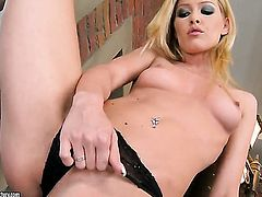 Blonde Sophie Moone gets naked and masturbates with sex toy
