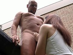 Badly hurt while playing, the poor oldman needs help. But his redhead young girl mate knows too little about this and decides to cares him with deepthroat blowjob, ball licking and hardcore care!