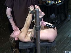 She gets laid and her legs are spread on the bar, being tied up together with her hands. Isis runs a vibrator on her twat, while that man tries to jizz on her face!