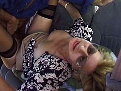 Blonde granny lifts the skirt up and gets her old pussy fingered. After that she gets fucked by much younger guy in the backseat.