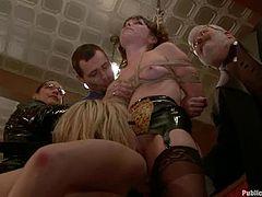 Smoking hot BDSM models are performing some torturing pleasures in public. They have a lot of viewers and they give a hell of BDSM show live!