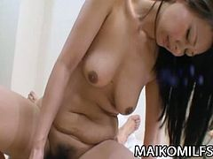 Satsuki Nakatsuka is a Japanese mom who gets her trimmed pussy pleasured with the help of a big vibrator. Then, she rides the cock of the man who just teased her.
