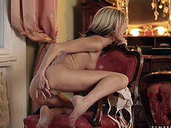Blonde beauty Doris Ivy strips and masturbates her shaved pussy