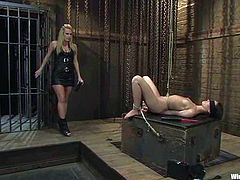 A gorgeous oiled up blonde is toyed and fucked by machine and strapon dildo in this wicked bondage lesbian session.