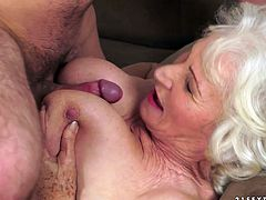Lustful old bitch gets her tits and hairy pussy licked. Later on she gives a blowjob and gets fucked by much younger dude.