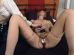 Naughty blonde girl gets tied up and then gets her pussy toyed with glass electric dildo by another chick.