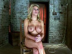 Curvy blonde Charisma Cappelli is getting naughty with some guy in a basement. She lets him tie her up and gives him a deepthroat blowjob and then gets her snatch pounded with a dildo.