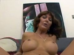 Slutty MILF measures the dicks with a ruler. Then she gives him a blowjob and gets fucked hard on a sofa.