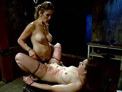 Hot girl gets spanked and then tied up by two mistresses. Later on she also gets her pussy and tits pinched with claws.