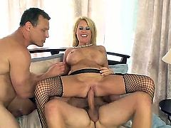 Two fellows are having tons of fun with this nasty blonde slut Grace Evangeline. She stays in black fishnets and black high heels before getting double penetrated.