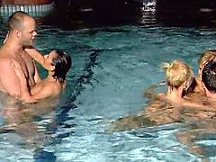 Antoanella, Eva and Kata Lynn are having fun with two dudes in a pool. They show their cock-sucking skills to the men and then allow them pound their cunts deep and hard.