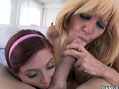 Moms Tara and Penny are two filthy whores that love to suck cock! They greedily share this dude's like sluts and one sucks on his cock while the other one, his balls. Which one will receive the cumload?