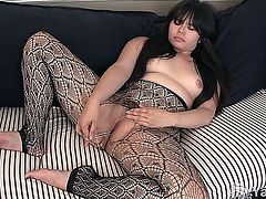 Voluptuous Asian girl Hermine fingering and toying her hairy slit on the couch