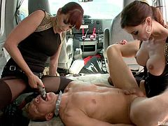 Gia Dimarco and Maitresse Madeline are playing dirty games with some dude in a minivan. They play with his dick and make him lick their snatches and then fuck his mouth and ass with strapons.