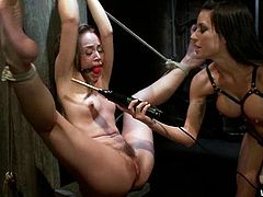 Gia Dimarco is having fun with Kristina Rose in a basement. Gia binds Kristina up, pokes a dildo in her juicy vag and makes her cum a few times.