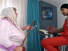 Blonde grandma Sara is a chubby old whore that drools for big black cocks. Franco sees what a slut she is so he undresses the granny and plays with her huge breasts. Then, Sara kneels, opens her mouth and sucks his black rod. She even rubs it with her huge breasts and continues the head. Will he cum on her?