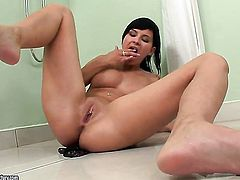 Brunette Abbie Cat gets naked and masturbates with toy