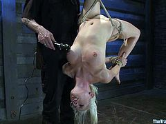 Gorgeous blonde Lorelei Lee allows some guy to restrain and hang her up in a basement. The dude plays with Lorelei's tits and then pinches her body and rubs her pussy with a dildo.