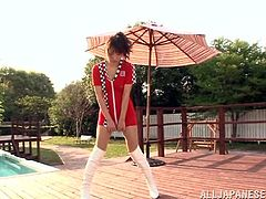 Lovely Japanese girl takes her dress off and shows her sexy body. Then she gives a blowjob and a titjob to some guy outdoors.