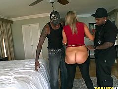 Briella Bounce is her name and you'd better show her some respect for handling two hungry black hommies at a time! Damn, she loves black cocks!