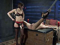 He stays there with his legs tied and spread wide, while the mistress enjoys every moment. Parker is about to have one hell of a ride with this divine bitch! She begins by fingering his tight anus and rubs his cock. Then, the mistress uses her strap on dildo and fucks him hard. She goes as deep, as she can in his ass