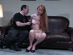 Long-haired redhead girl strips her clothes off at the casting. She gets tide up and then toyed with a vibrator.