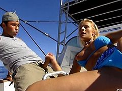Slutty blonde Sandra Russo is having fun with some dude on a boat. They have passionate oral sex and then the man smashes Sandra's butt in side-by-side position.