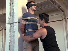 Lewd poofter James Riker is having fun with his dominant buddies. He gets bound and blindfolded and then enjoys a handjob and gets his ass pounded with a dildo.