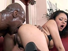 Watch this dirty fucking bitch suck on that huge black cock and get it fucking shoved balls deep into her fucking tight ass.