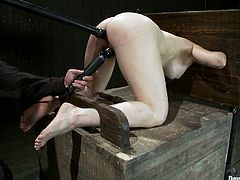Brunette mom Annika lets some guy put her into fetters in a basement. The dude beats Annika's shaved coochie and then makes the bitch take a ride on a fucking machine.