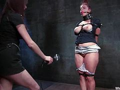 Nipples will be tortured, pussy will be toyed severely and limbs will be tied with ropes in this lesbian BDSM session.