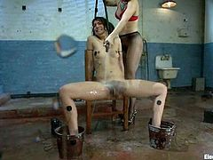 Slim brunette chick with curly hair gets wired and poured with water. Later on she also gets toyed by her mistress.