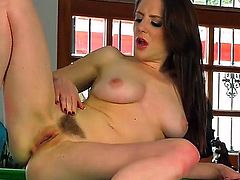 Cute tight ass brunette Samantha Bentley with nice natural boob sand long legs in provocative violet undies and high heels teases and starts fingering hairy twat on billiard table.