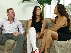 Holly is between Francesca and Mark, and they all feel horny. Mark and his girlfriend taunt Holly and soon things get hot and heavy. Holly is knelt and Francesca the girl's mouth widely so the guy can fuck her throat. They've then share his penis and Holly receives a mean pussy lick while she continues to suck dick.
